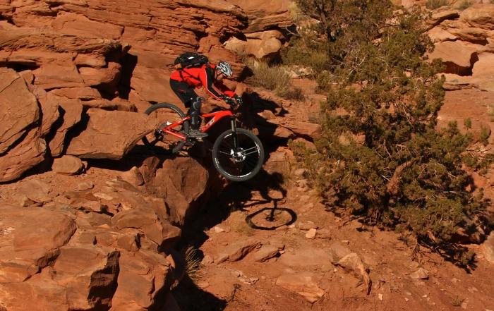Lunchbox cliff drop red desert